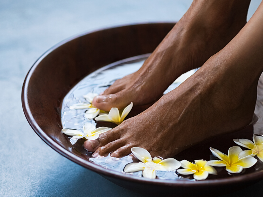 feet soaked in floral water for spa treatment at Amora Hotel